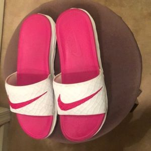 Nike slides hot pink and white.